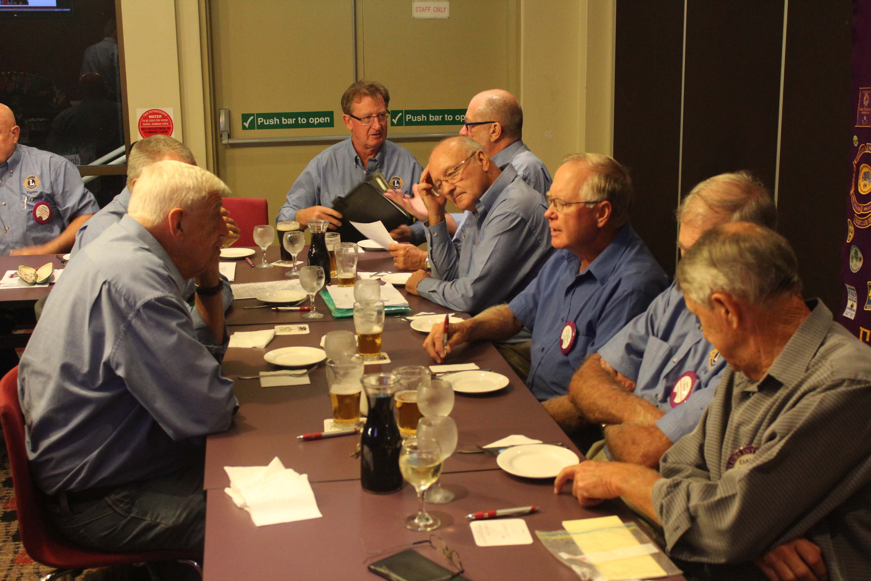 Lions club members seated at table